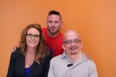 Train to Inspire founder Joe Hogan, volunteer Tracy Keninger, and participant Dave Mathis