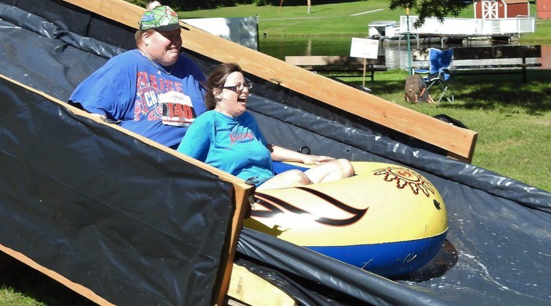Megan and Adam on slide